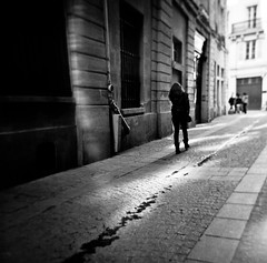 Girl walking in the street, Paris (Agacha) Tags: bw white black paris france holga scanner type hp5 ilford argentique lieux photosderue homeprocess agacha
