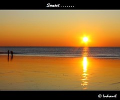Golden Beauty..... (Indranil.m) Tags: christmas travel sunset sea vacation orange holiday france color beach nature water beauty canon golden europe december group le havre 100 quite 2008 normandy comment indranil mukherjee 450d 100commentgroup