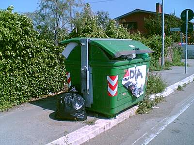 waste skip along the street near Rome