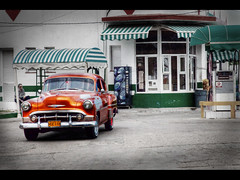 The orange car (Kaj Bjurman) Tags: orange classic car station eos cuba gas american 5d 2009 havanna hdr kuba kaj mkii markii bjurman