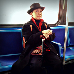 The Woman with the Bowler Hat (antonkawasaki) Tags: nyc portrait newyork bus cane square streetphotography explore bowlerhat iphone dignified 500x500 explored stphotographia antonkawasaki m14bus womanonbus dignifiedwoman