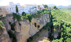 Ronda Cliffs (cwgoodroe) Tags: summer costa white hot sol beach del bells spain ancient europe churches sunny bull bullfighter adobe ronda moors walls washed clothesline protective newbridge roda bullring stonebridge oldbridge spainish whitehilltown rondah spanishdoors