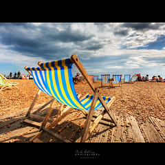 The Great British Summer (Mike Golding) Tags: blue sea summer england beach beer sunshine yellow clouds coast chair brighton stripes f10 deck southcoast hdr 10mm sigma1020