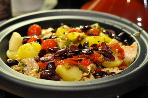 Monkfish tagine with potatoes, kalamata olives, cherry tomatoes, and roasted peppers