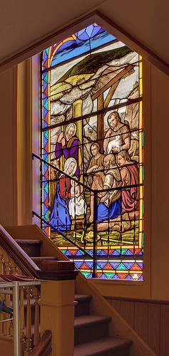 Immaculate Conception (Saint Mary's) Roman Catholic Church, in Brussels, Calhoun County, Illinois, USA - stained glass window of the Nativity; stairs leading to the choir loft