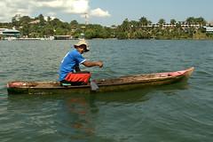 Crab Fisherman in Guatemala (Laveen Photography (aka cyclist451)) Tags: fishing log guatemala canoe crabs livingston centroamerica dugoutcanoe puertosantothomasdecastilla