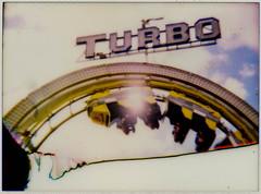 Turbo F***ed (AndyWilson) Tags: film beach pier lomo brighton fuji arse diana instant rides funfair instax instaxback