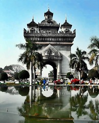 Reflection of ancient times (wishingheart) Tags: vacation people reflection monument ancient place time tourist historical times laos lao touristattraction vientiane laotian commemorate patuxai ancienttimes victorygate gateoftriumph capitalcityoflaos reflectionofancienttimes