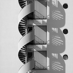 Double Helix (Udo Haberl) Tags: city windows light shadow urban blackandwhite bw white abstract black art window netherlands monochrome lines matrix wall architecture stairs composition square maastricht geotagged spiral lumix grey lights europe solitude pattern angle loop geometry curves double symmetry minimal stairway panasonic explore staircase silence crop repetition dna fv10 helix ladder minimalism coil rectangle emptiness circular blackdiamond rectangular ogm linescurves photographia flickrsbest blackwhitephotos abigfave lx3 anglesanglesangles lumixaward absoluteblackandwhite ostrellina world100f windmillsspirals obq oraclex blackdiamondpremier alwaysexc goldenart phvalue topabstract