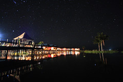 GIC (Inle) under the starry sky (Kyaw Photography) Tags: longexposure lake reflection water stars landscape burma tripod inle nightscene ultrawide bungalows canonefs1022mm freeburma 40seconds canoneos450d gichotel kyawphotography yeyintkyaw