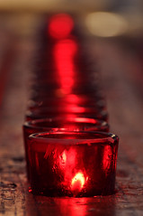 A Candle for a Soul (laverrue) Tags: wood nyc light red blur church st rouge hope memorial candle dof bokeh spirit manhattan faith worldtradecenter pray 911 chapel pauls financialdistrict burn soul trinitychurch gothamist groundzero ground0