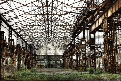 decaying industrial building overtaken by nature