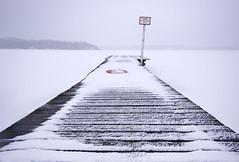 Desolate (Paul Marculescu) Tags: winter sea snow cold water sign frozen dock sweden jetty lifebuoy buoy trosa dsc4416