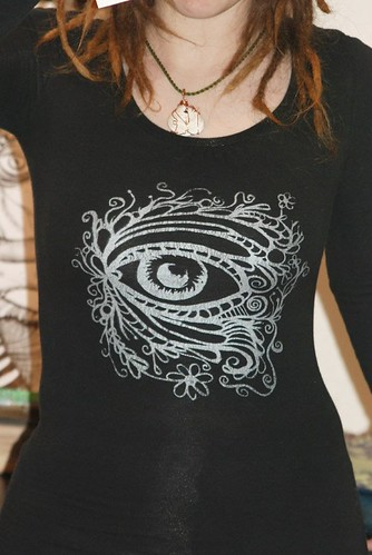 Behold screen-print: in silver metallic on black long sleeve shirt.