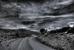 El camino sin fin (hiskinho) Tags: sky bw cloud clouds landscape camino carretera paisaje bn ciel cielo nubes rbol nuage nuages hdr nube senda tierra