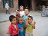 kashgar kids (Xuan Che) Tags: 2005 china street city travel girls friends summer portrait boys children happy pretty august oasis xinjiang silkroad kashgar uyghur centralasia canonixus400 islamic eurasia