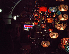 lamps in istanbul. (ali khurshid) Tags: bridge film turkey 50mm daylight nikon fuji tulips turkiye slide istanbul iso velvia 100 nikkor f18 f5 galata eminonu
