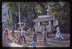 Milk Stand - IN 1987 Car1-018 (Eric.Parker) Tags: street india milk 1987 telephone slide scan bombay africanamerican mumbai bengal westbengal scannedfromslide