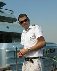 Cruisy captain (Roving I) Tags: sunglasses captains lifestyle cruising australia melbourne personalities shorthair uniforms yachts luxury platinum skippers launches epaulettes