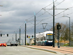 A Link light rail train passes through the Rainier Valley while testing. Photo by Oran Viriyincy.