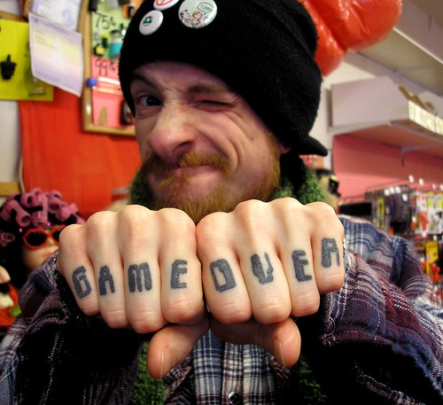 Jeff's Game Over Knuckle Tattoo