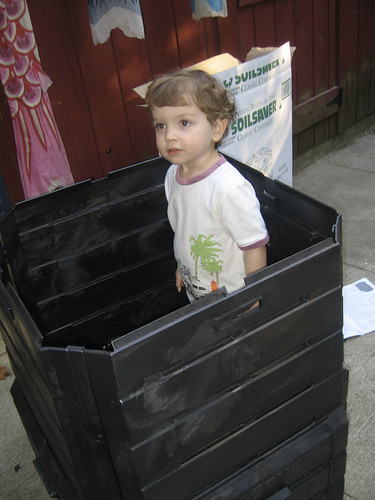 dylan checks out our new composter from the inside