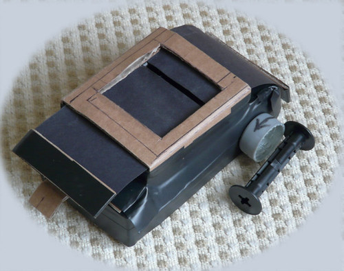 Compact camera sliding slot shutter