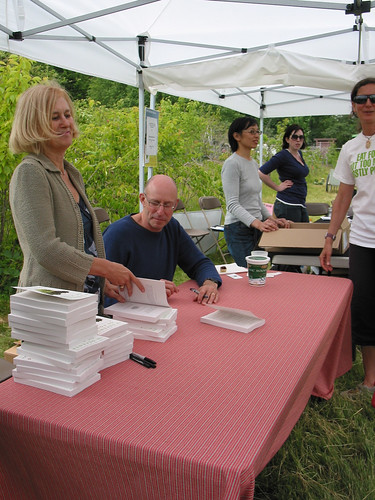 Michael Pollan at the book signing table, UBC Farm