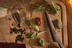 Herbs and spices still life (dickiesandchucks) Tags: cinnamon sage masonjar rosemary peppercorns thyme global cuttingboard garlicsalt bayleaves