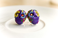 dia de los muertos violet earrings (Chili Crab) Tags: flowers blue green leaves yellow dayofthedead skull one chili purple crystal handmade ooak peach earring magenta violet crab jewelry kind fimo lilac clay diadelosmuertos swarovski etsy 2009 studs rasberry sculpted polymer