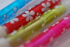 DSC_1365 (incurable_hippie) Tags: flowers blur macro cute floral aperture bright multicoloured depthoffield colourful pens