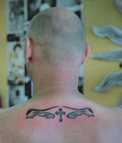 irish celtic cross tattoo · rams with cross tattoo