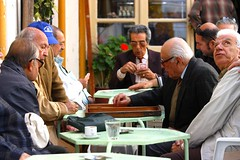 Game of tavli (Marite2007) Tags: friends people game men islands concentration hellas social games hobby greece typical mates rhodes enjoying backgammon rhodos socialize tavli
