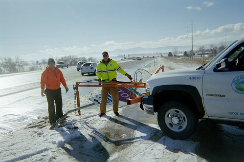 City crew replacing damaged street sign