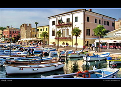 le barche di Bardolino Verona Italy..... (FIORASO GIAMPIETRO ITALY....) Tags: travel people italy lago landscapes photo bravo europe italia group barche best verona vacanza visualart vacanze vicenza lagodigarda faved veneto greatphoto panorami naturesfinest ladscapes theworldwelivein magicdonkey naturepeople flickrsbest fioraso kartpostal giampietro anawesomeshot colorphotoaward aplusphoto goldcollection holidaysvacanzeurlaub flickraward frhwofavs theunforgettablepictures overtheexcellence goldstaraward alemdagqualityonlyclub photoshopcreativo grouptripod vosplusbellesphotos artofimages sensationalphoto savebeautifulearth scattifotografici fiorasogiampietro bradolino updatecollection bestcapturesaoi flickrunitedwinner obramaestra