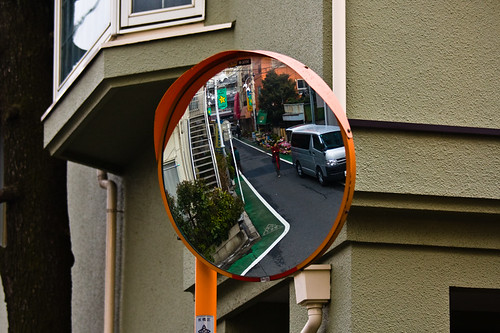 traffic crossing mirror with a van and woman