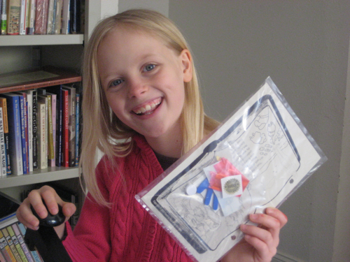 Zippy showing off one of the four hundred crafts that she has to package
