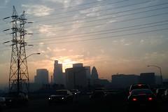 LA Freeway Silhouette (Kelson) Tags: cameraphone city sunset urban cars buildings la losangeles powerlines freeway ushighway101