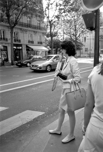 Woman eating baguette, Paris