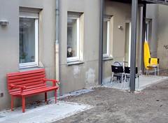 red bench and yellow sunshade (Winfried Veil) Tags: red berlin rot yellow umbrella kreuzberg germany bench deutschland veil bank sunshade gelb distillery mitte winfried hinterhof sonnenschirm mobilew winfriedveil
