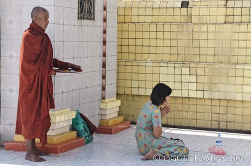 botataung monk and lady worshipper