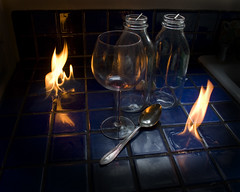 Prometheus (nhaddal) Tags: stilllife glass canon fire wine bottles spoon tiles pyrotechnics