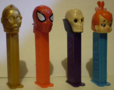 Pez dispensers of C3PO, Spider-Man, Skull and Pebbles