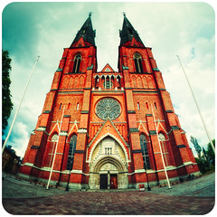 Uppsala Cathedral II (manganite) Tags: red sky panorama white color church topf25 colors architecture clouds digital photoshop vintage buildings dark geotagged iso200 interestingness xpro nikon colorful europe soft mood cathedral distorted cloudy sweden tl framed bricks grain perspective dramatic vivid historic explore frame highsaturation uppsala stitching cropped d200 grainy f56 nikkor dslr noise vignette stitched noisy spherical lightroom domkyrka l05 uppsalacathedral nikond200 interestingness69 i500 18200mmf3556 manganite colorefexpro 1640sec uppsalalän 6raw roundedges date:day=11 date:year=2009 format:orientation=square format:ratio=11 1640secatf56 date:month=juni geo:lon=1763204 geo:lat=59858108