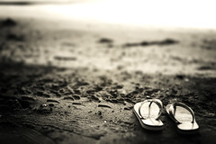 at the beach (MarianneLoMonaco) Tags: bw white lake black beach sand wasaga flip flop