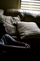 Blank stare (Tristan Rojas79) Tags: light blur window dark happy person grey alone watch gray tags pillow couch lonely tones cooltones