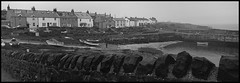 Craster pan1 (redeyesatdawn) Tags: blackandwhite bw film wall boats bay panoramic hasselblad northumberland xpan craster smokedfish kippers