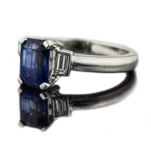 jeweller in emerald cut sapphire engagement ring