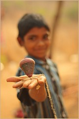 ~ Play... the game of life :) (Adarsh Padegal) Tags: boy india kids canon children toy rebel 50mm prime kid child top hyderabad andhra adarsh pca hpc xsi 50mm18 telugu kbr lpc adarshpadegal  pcaeyecatcher pcabestof2009