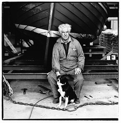 Don Brady. Fisherman, Crofter and Wedding Photographer. Grimsay, North Uist, Outer Hebrides, Scotland. (carolannpeacock) Tags: old portrait blackandwhite bw shells white fish man black west industry field vintage mediumformat magazine hair islands coast scotland countryside boat inflight fishing fisherman workers artistic harbour sheepdog rustic north scottish august gritty donald hasselblad ilfordhp5 portraiture squareformat article shellfish seafood don analogue brady britishairways wrinkles westernisles npg isles authentic oldguy uist realism countrylife crofter kallin hebridean northuist table11 grimsay businesslife crabshakk